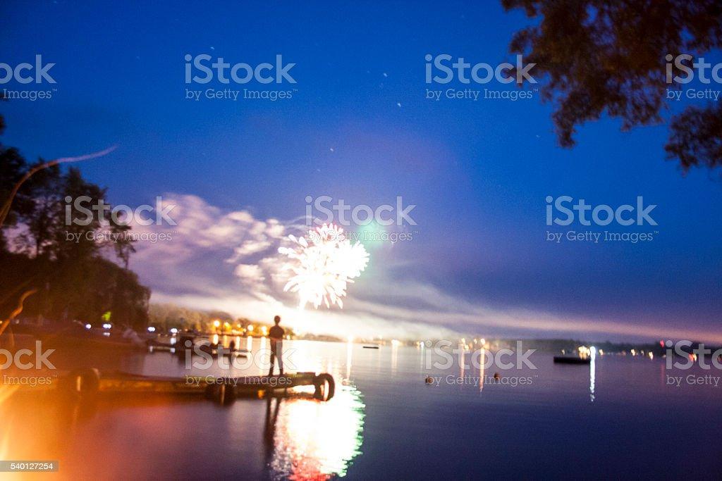 Boy watching fireworks stock photo