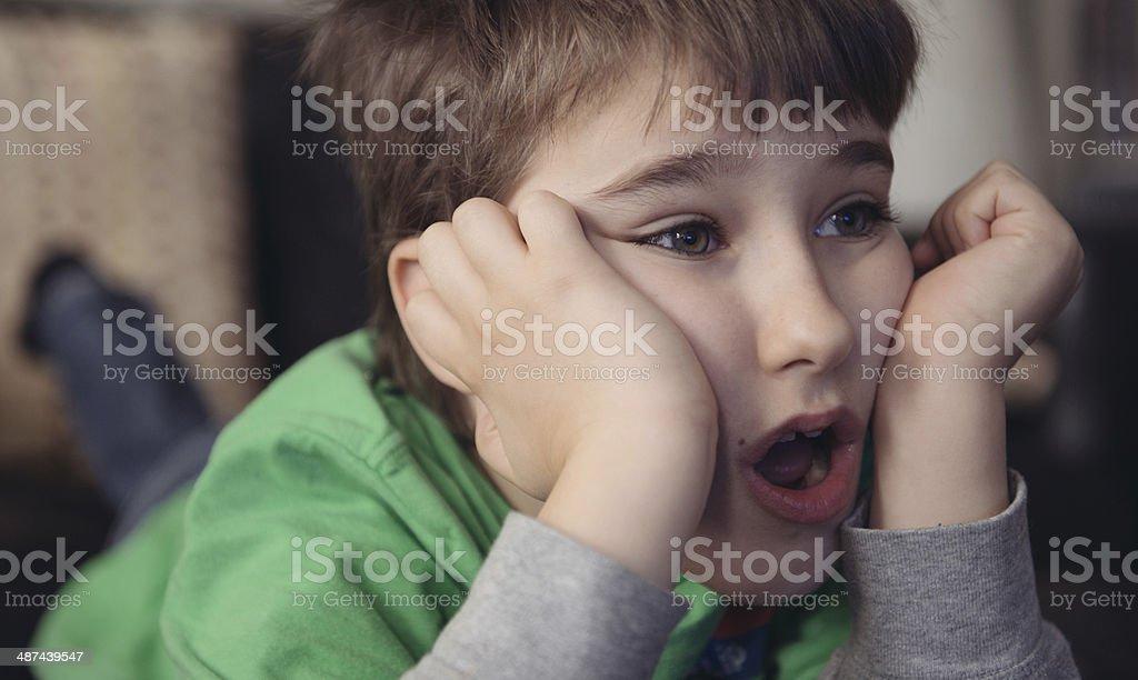 Boy watching TV stock photo