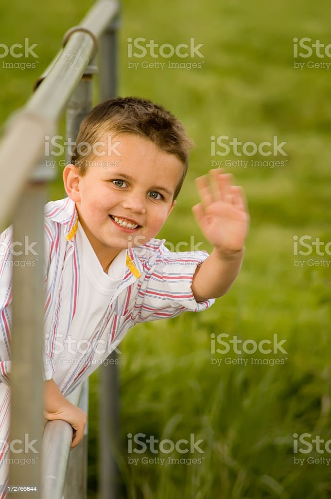 Boy Waves Goodbye royalty-free stock photo