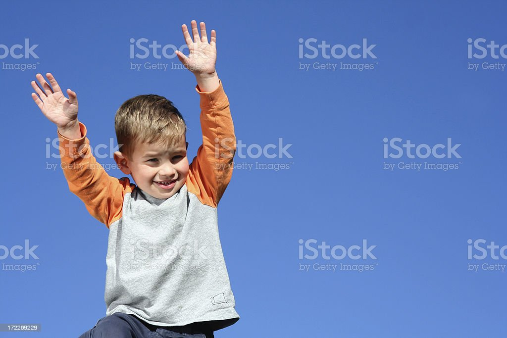 Boy waving hands in the air. royalty-free stock photo