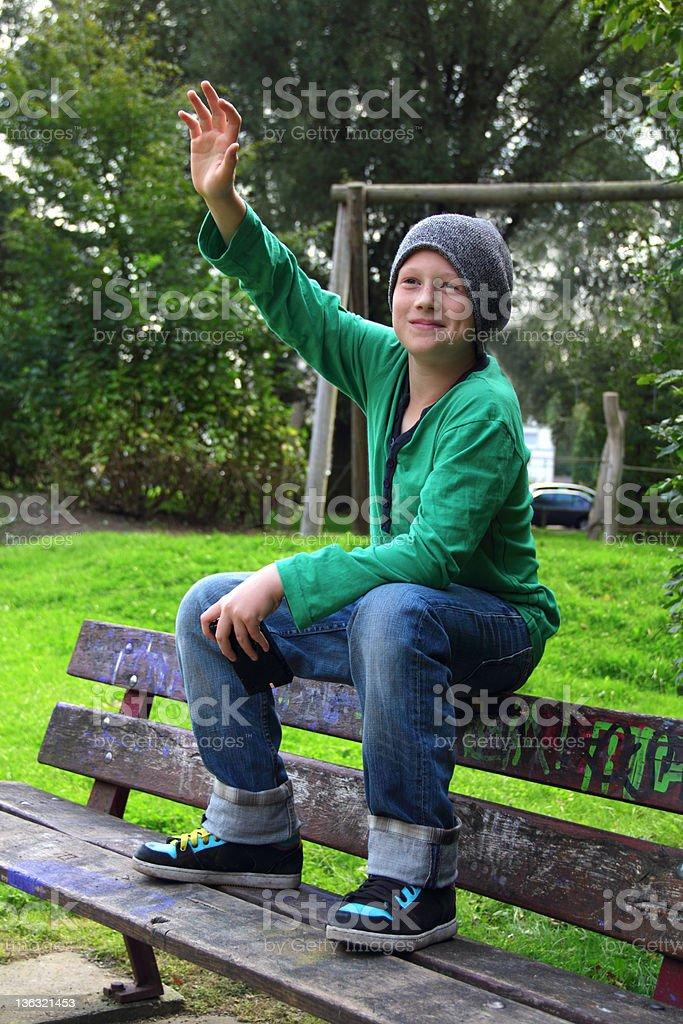 boy waving stock photo