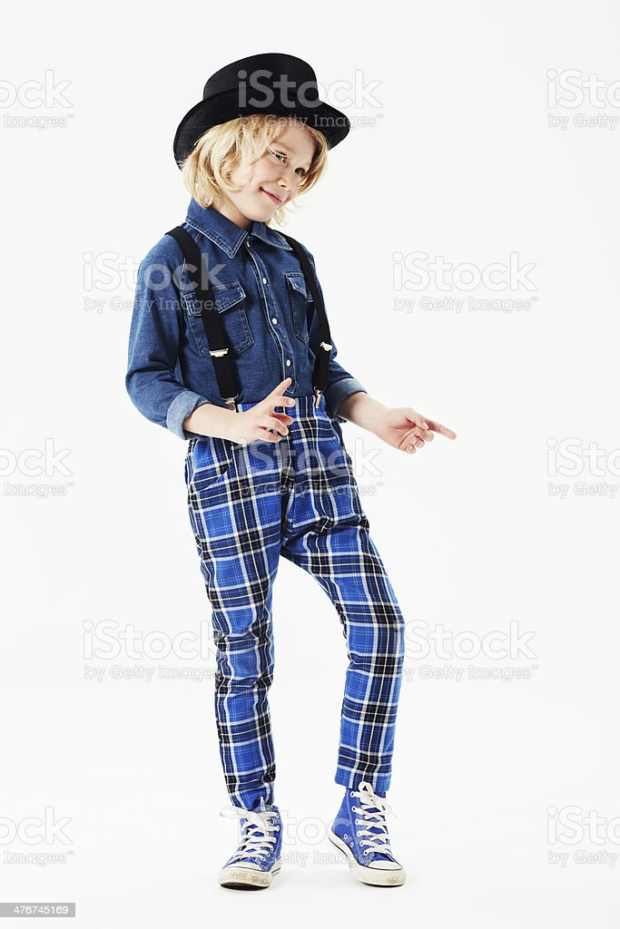 Boy wearing checked trousers and hat in studio stock photo