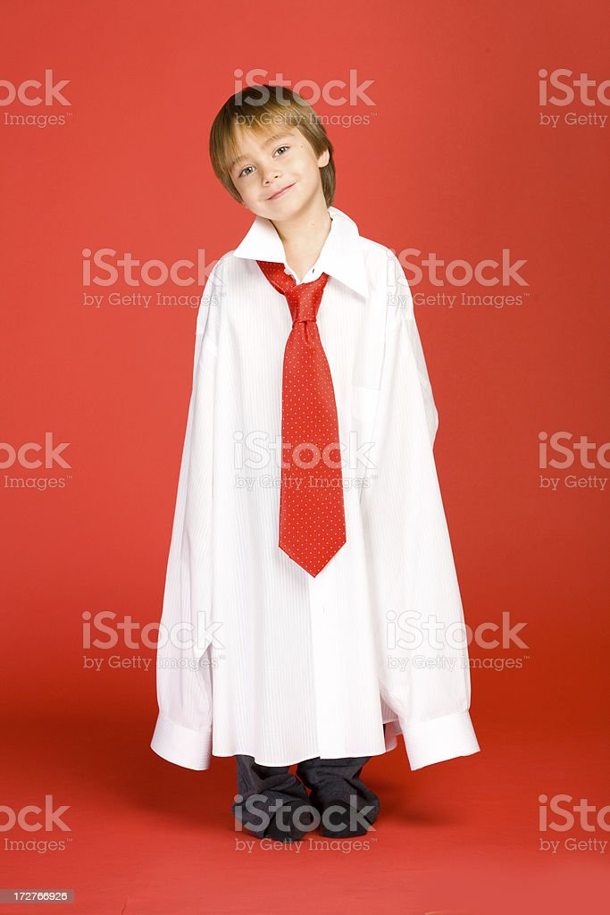 Boy wearing oversized business clothing. royalty-free stock photo
