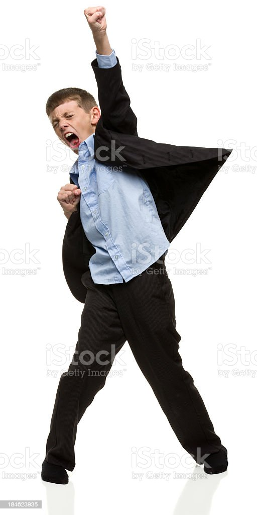 Boy Wearing Suit With Fist in Air stock photo