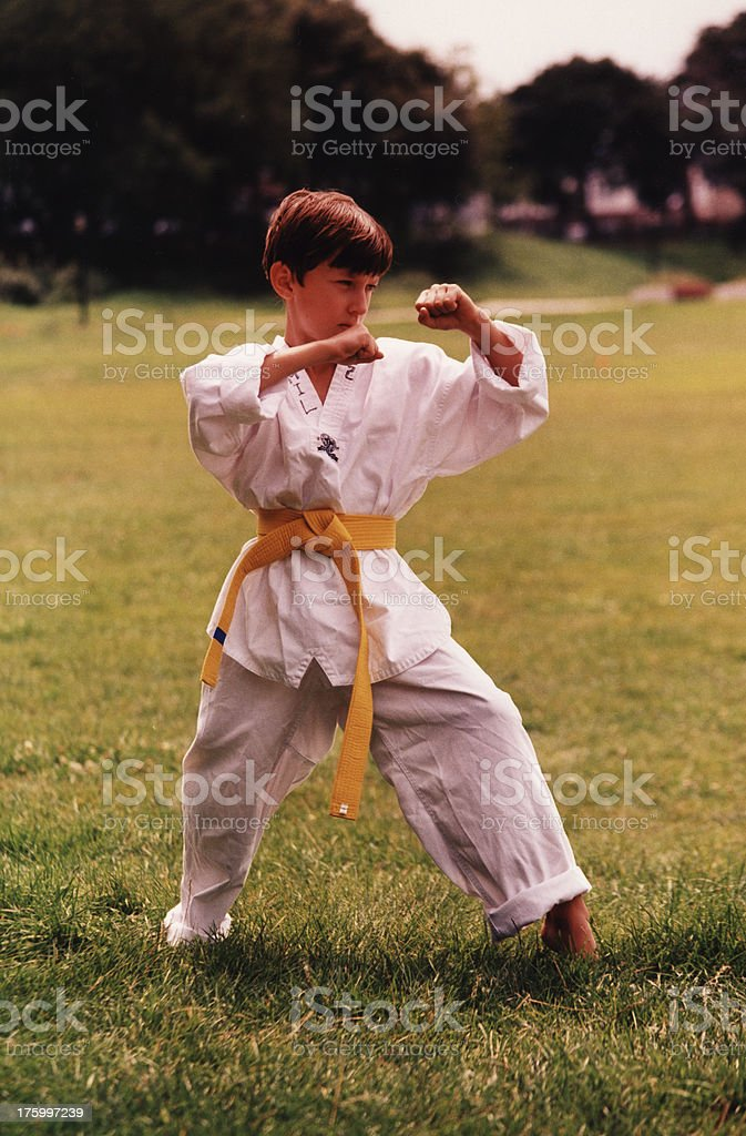 Boy wearing Tae-Kwon-Do uniform royalty-free stock photo
