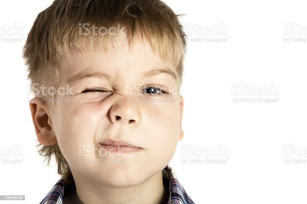 Boy winking stock photo