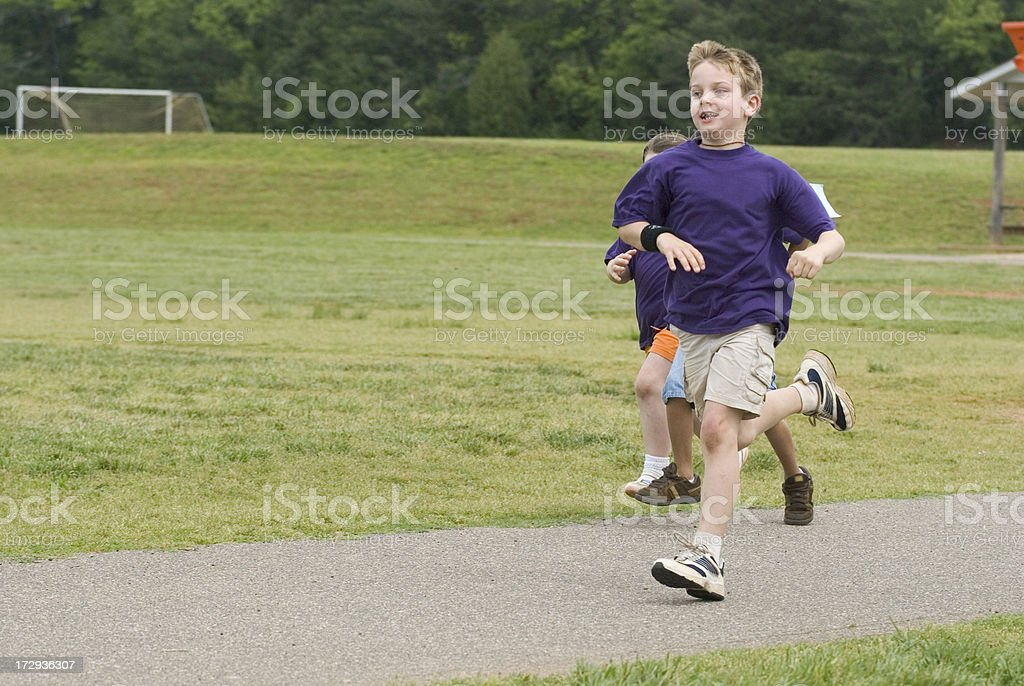 Boy Winning A Running Racing At Field Day royalty-free stock photo