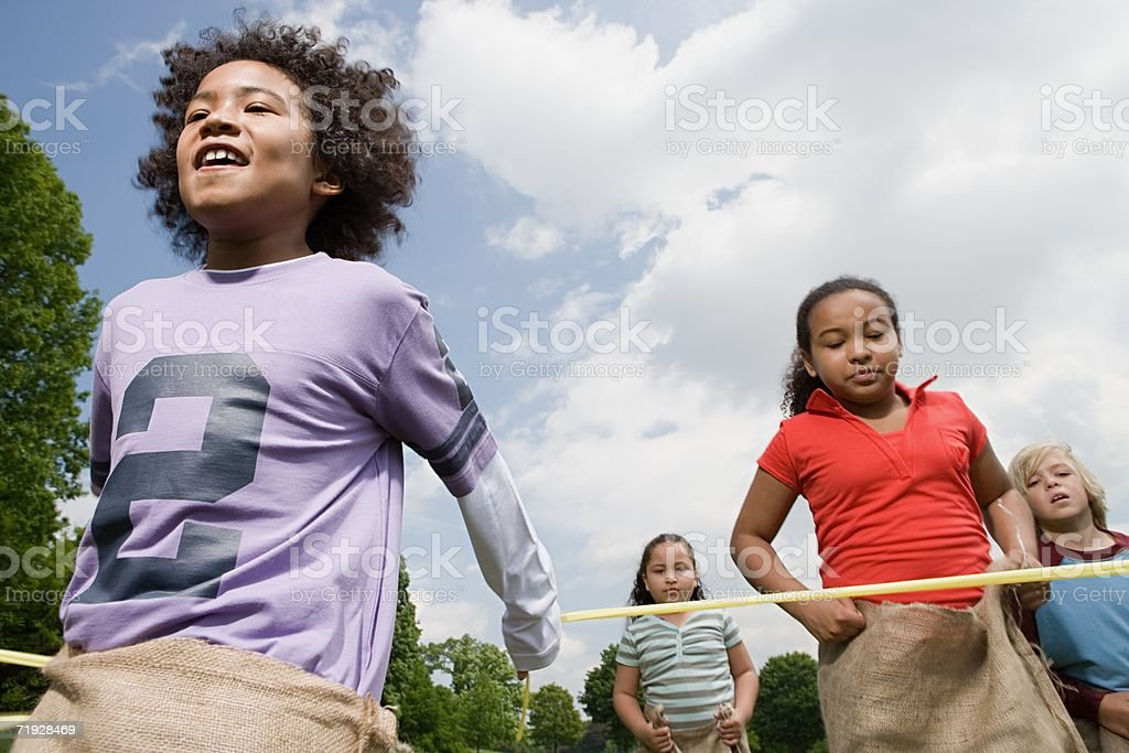 Boy winning sack race stock photo