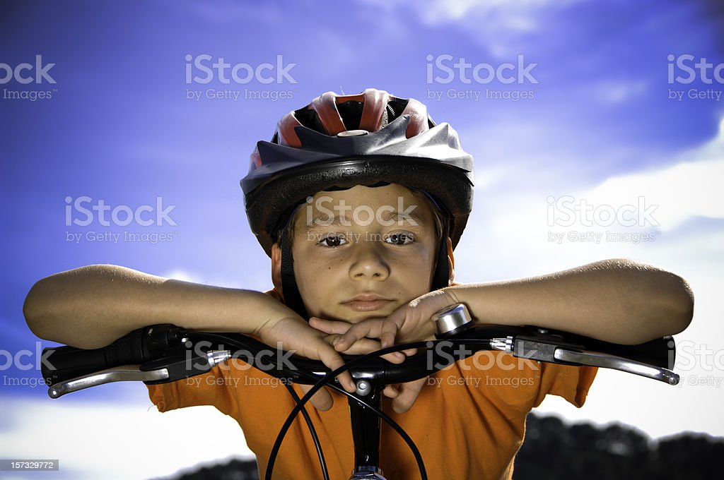 Boy with a bike helmet stock photo