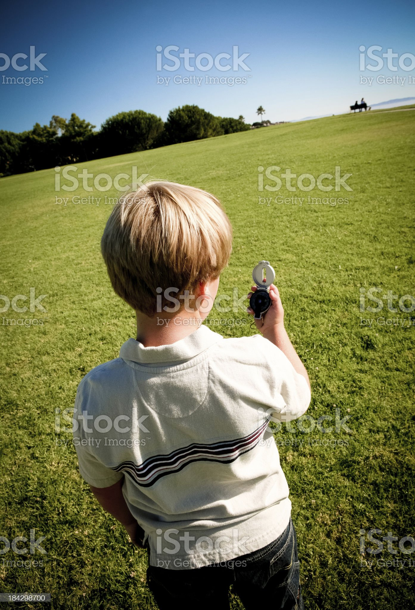 Boy with a compass royalty-free stock photo