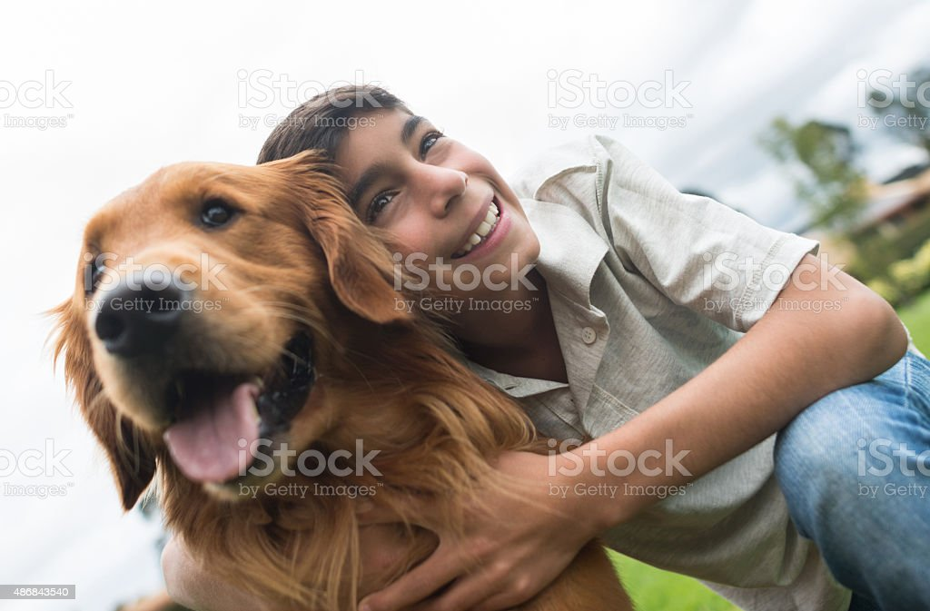 Boy with a dog at the park stock photo