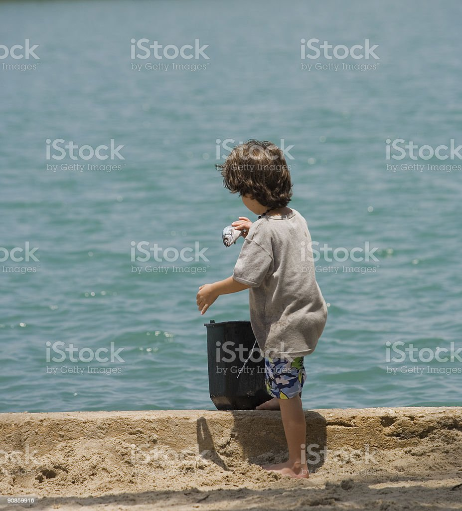 boy with a fish in his hand stock photo