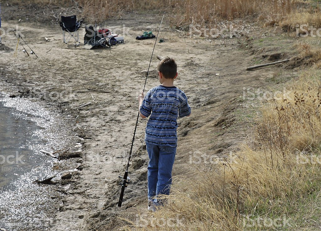 Boy with a Fishing Pole at the Lake stock photo