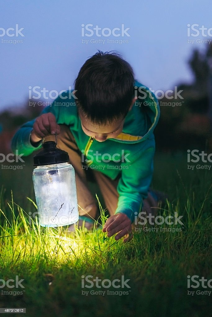 boy with a lantern stock photo