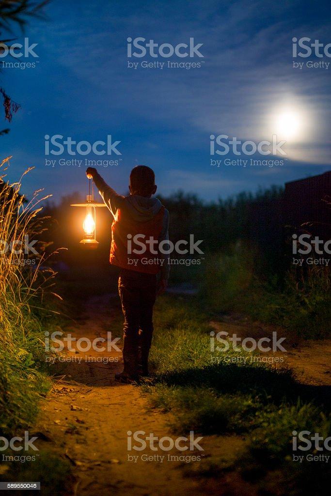 boy with a lantern stock photo