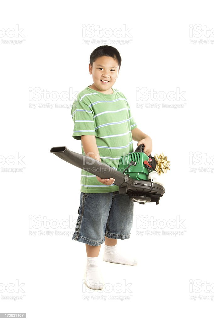 boy with a leaf blower present stock photo