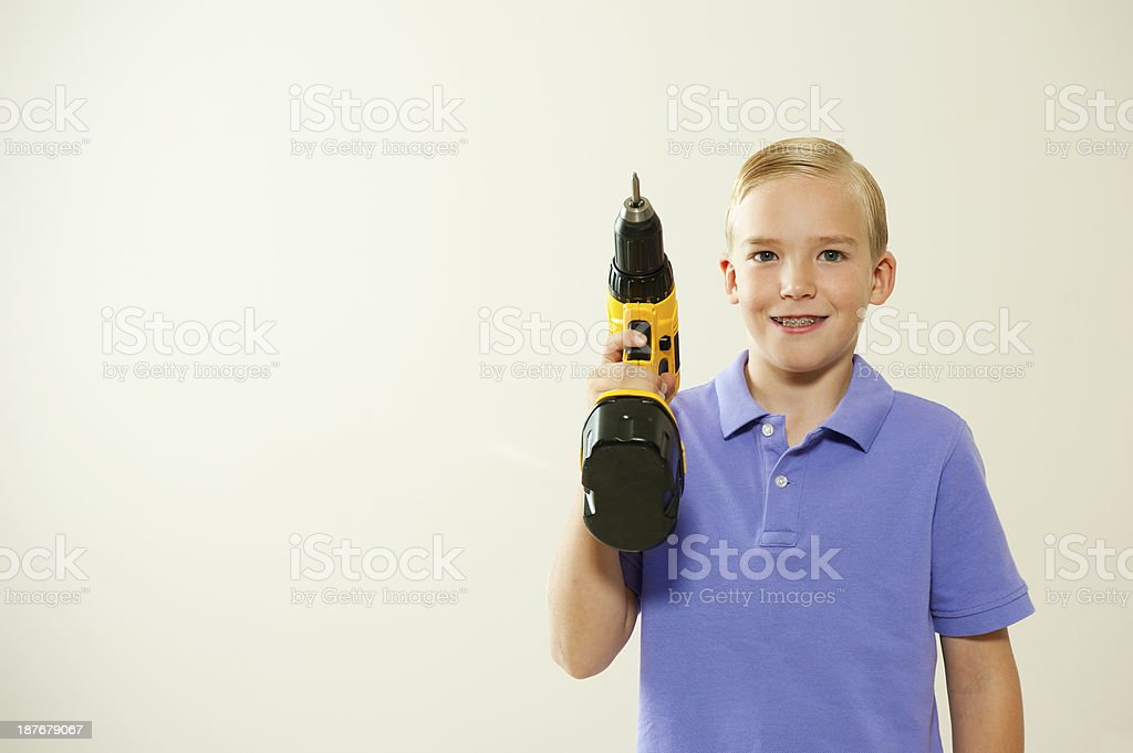 Boy with a power tool royalty-free stock photo