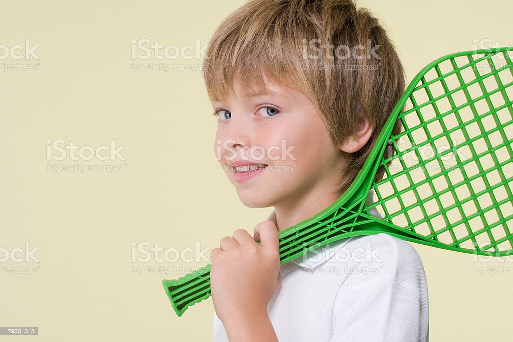 Boy with a tennis racket royalty-free stock photo
