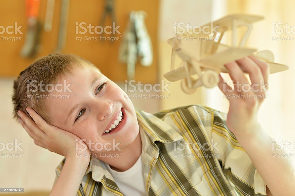 boy with a wooden airplane stock photo