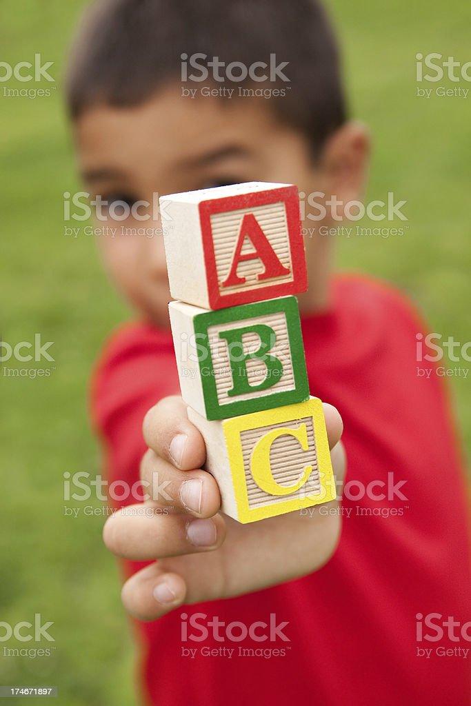 Boy with ABC blocks royalty-free stock photo