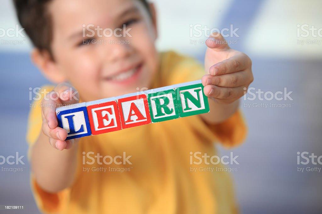 Boy with alphabet blocks royalty-free stock photo