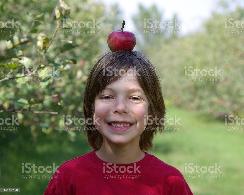 Boy with apple on head royalty-free stock photo