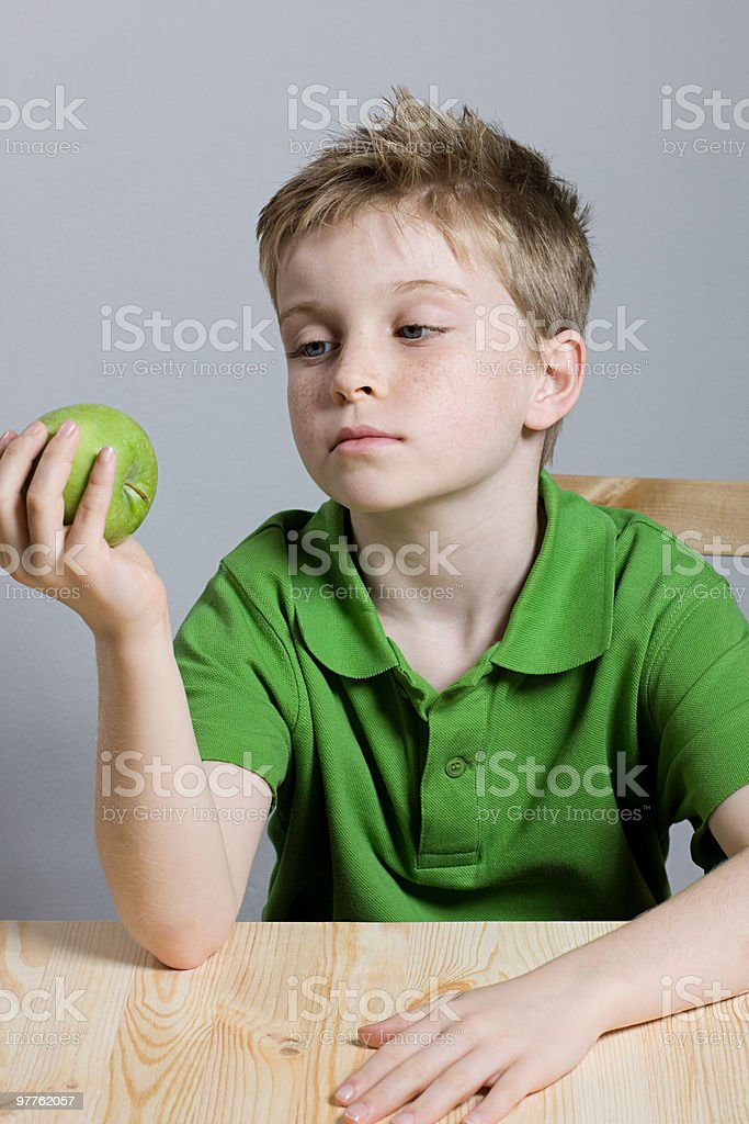 Boy with apple royalty-free stock photo