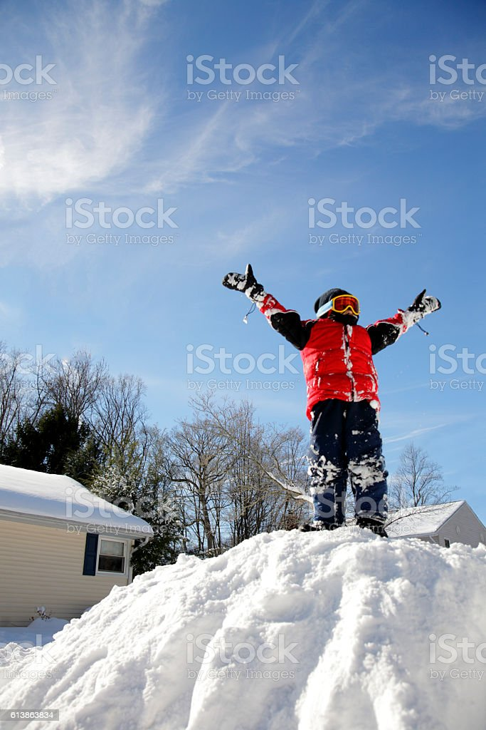 Boy with autism becomes King of the Hill in winter stock photo