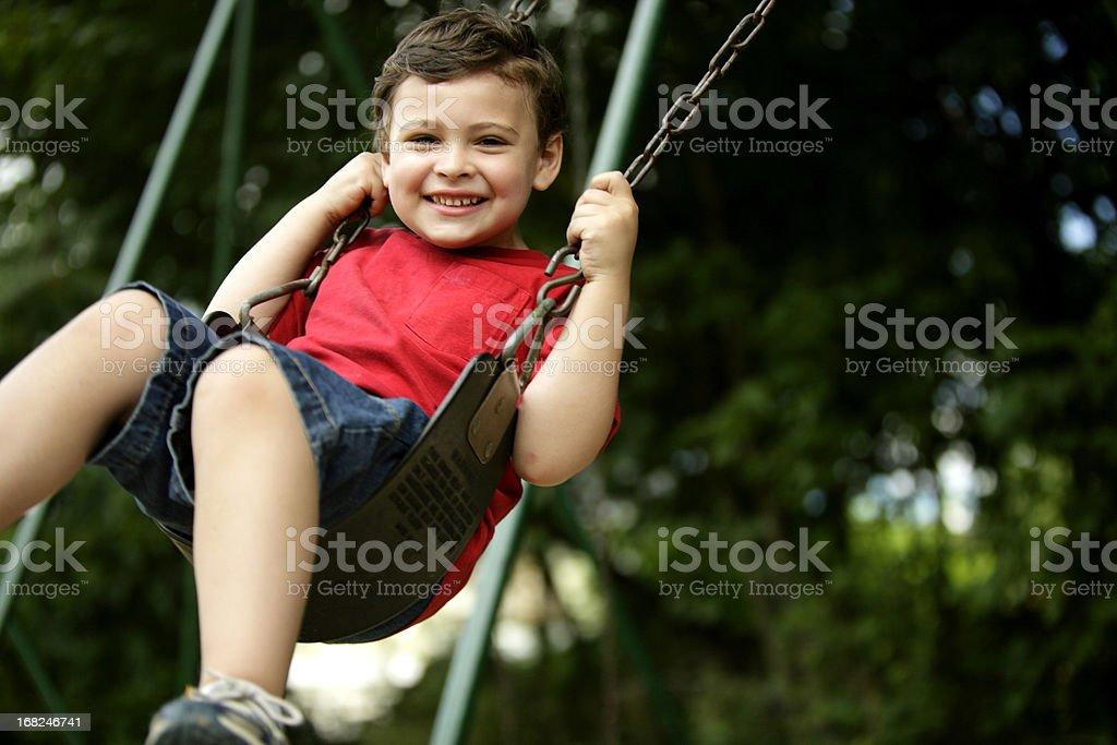 Boy with autism enjoys swing time stock photo