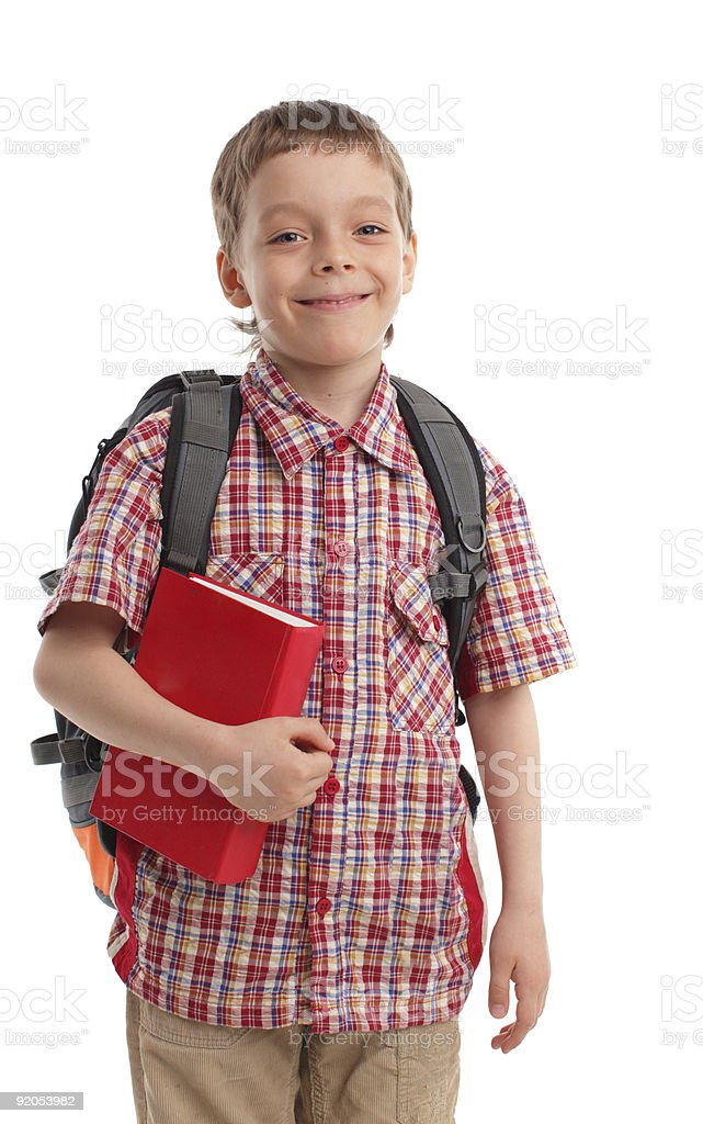Boy with backpack and book royalty-free stock photo