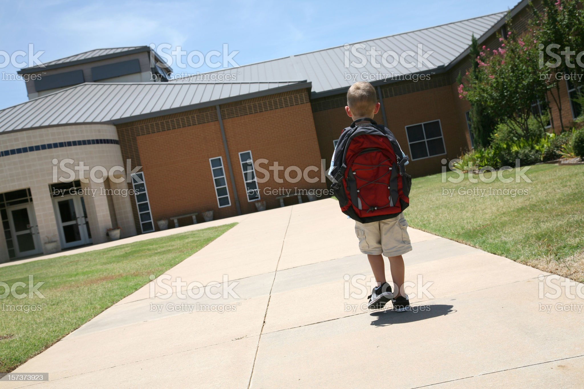 Boy With Backpack Walking To School On First Day royalty-free stock photo