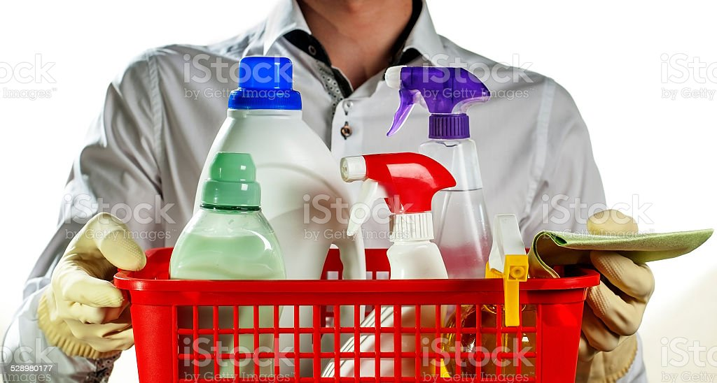 boy with basket of cleaning equipment stock photo