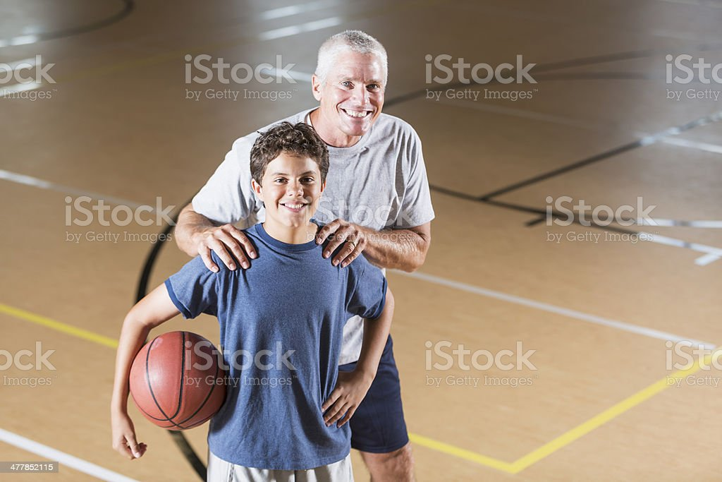 Boy with basketball coach royalty-free stock photo
