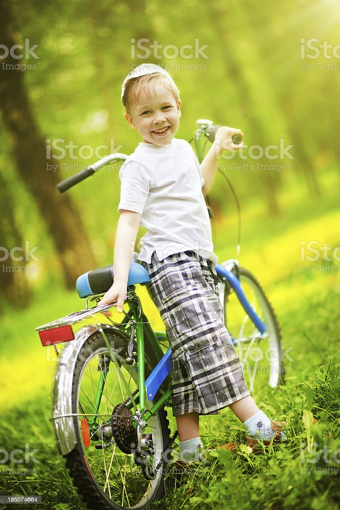 Boy with bicycle royalty-free stock photo