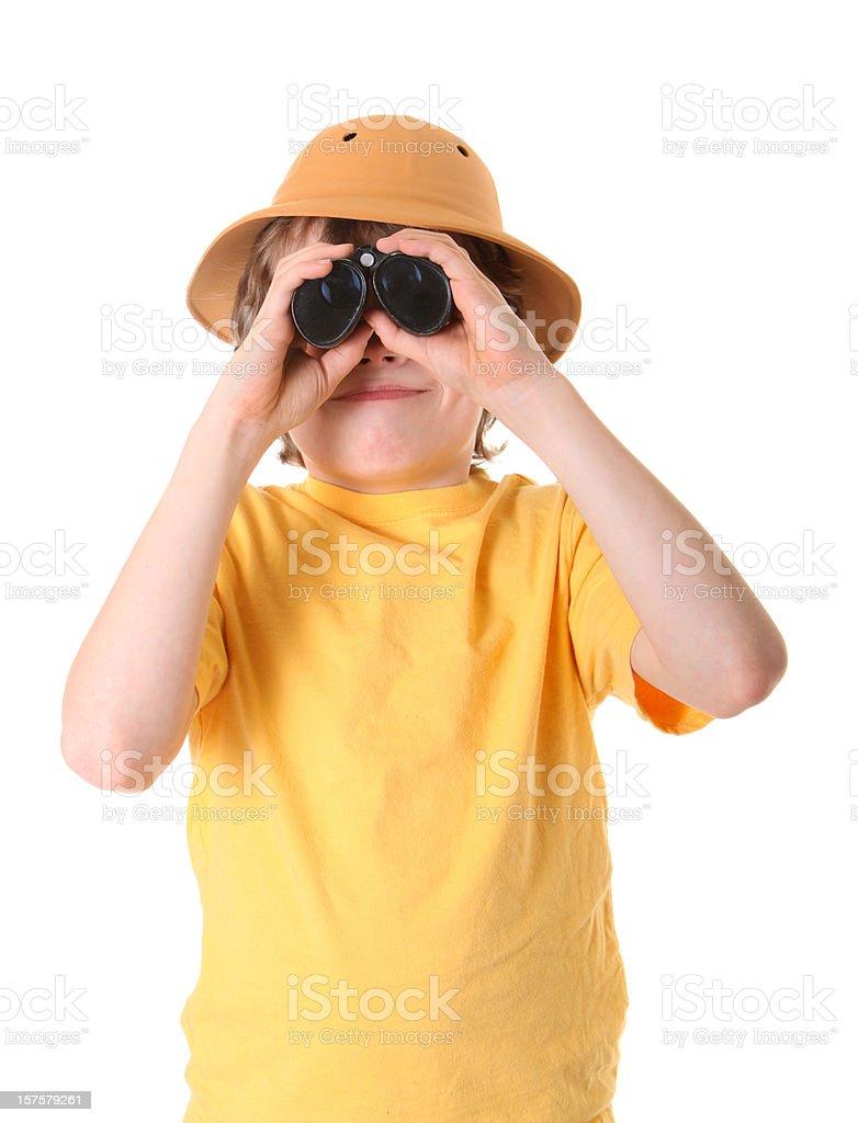 boy with binoculars and pith helmet royalty-free stock photo