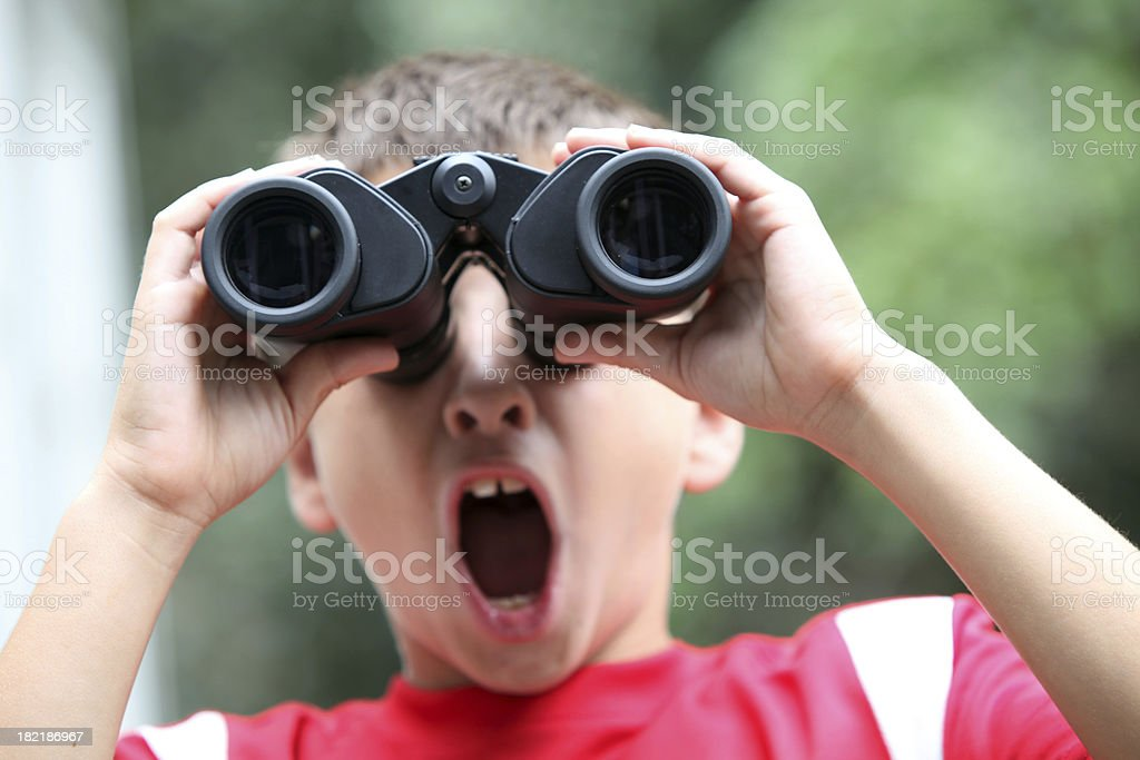Boy with binoculars royalty-free stock photo