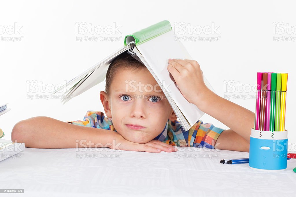 Boy with book on his head stock photo