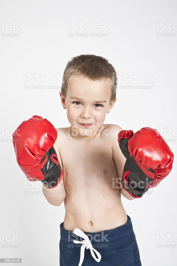 Boy with boxing gloves stock photo