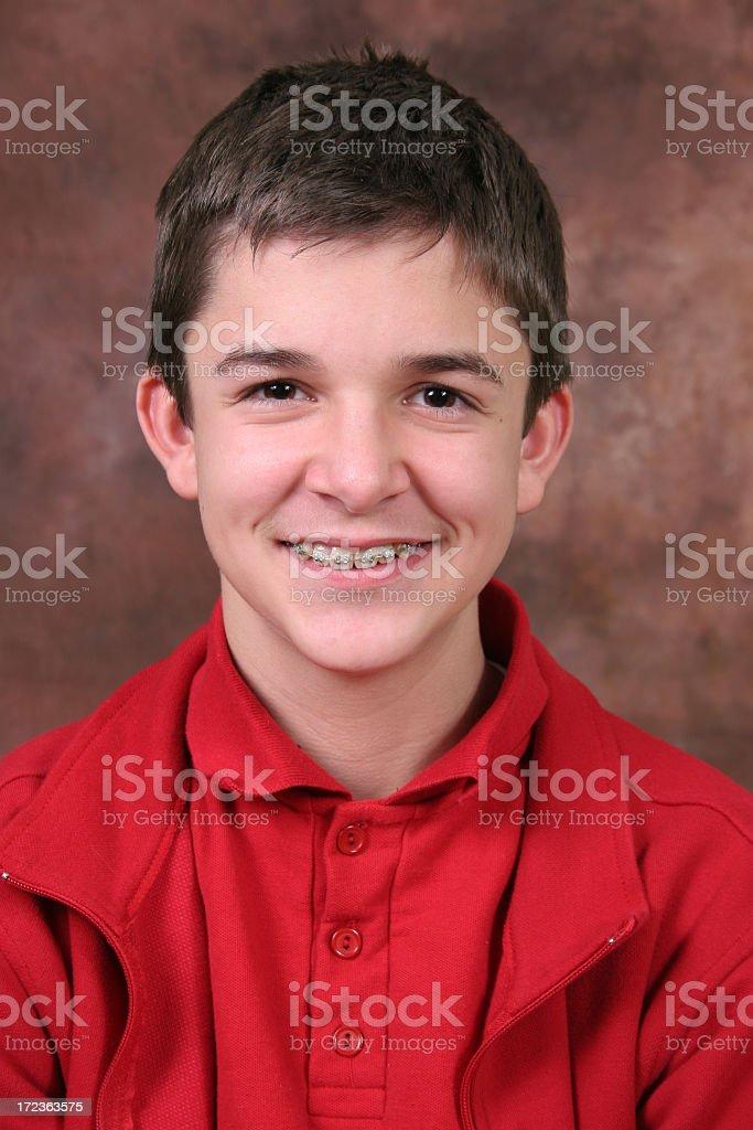 Boy with braces stock photo