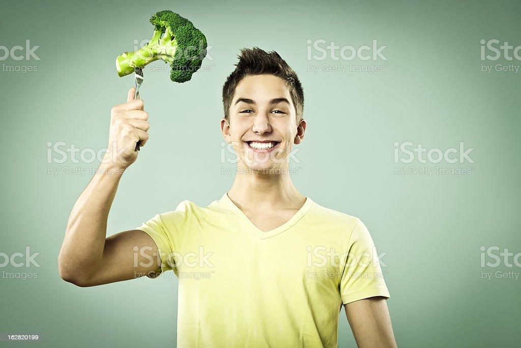 Boy with broccoli royalty-free stock photo
