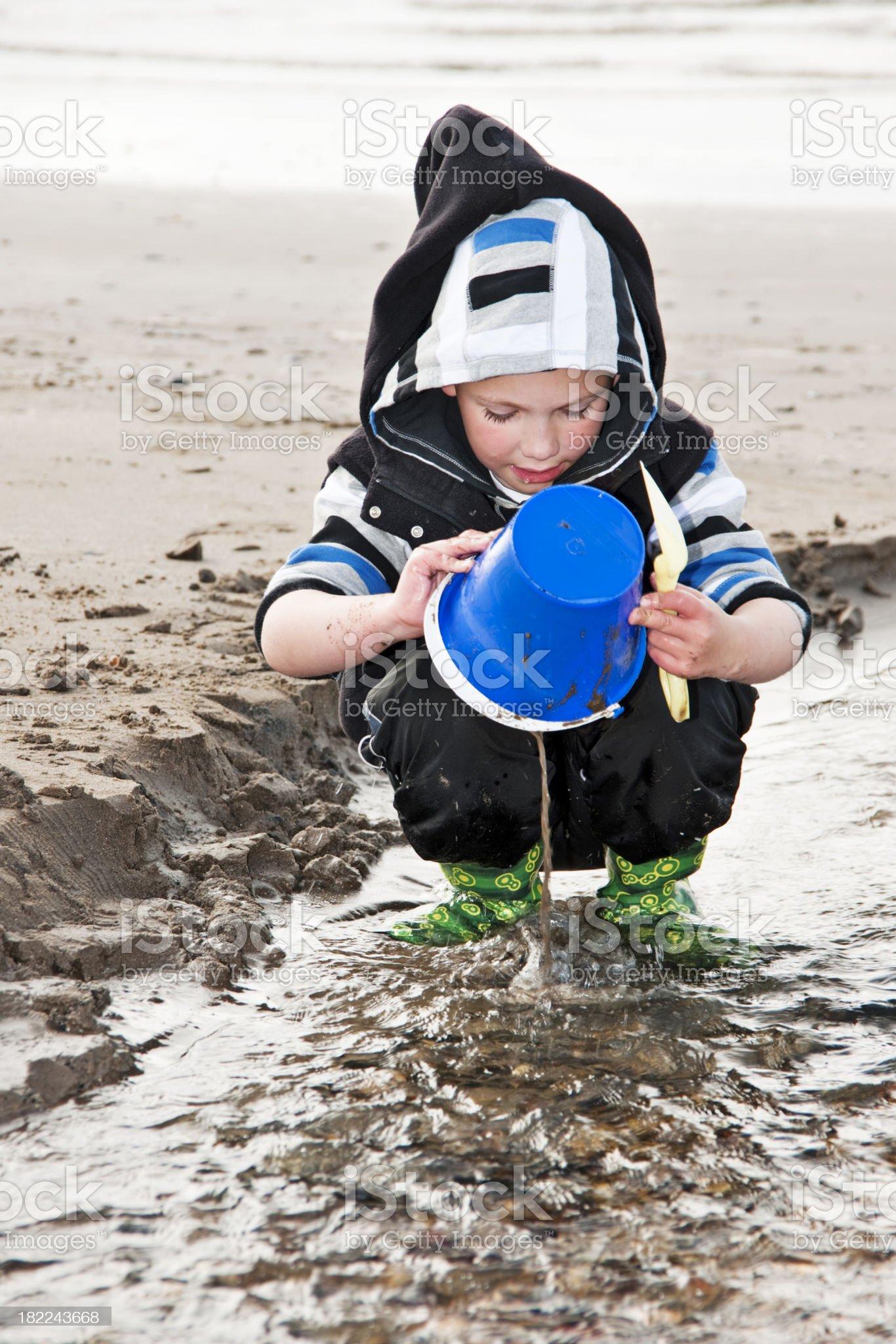 boy with bucket on beach royalty-free stock photo