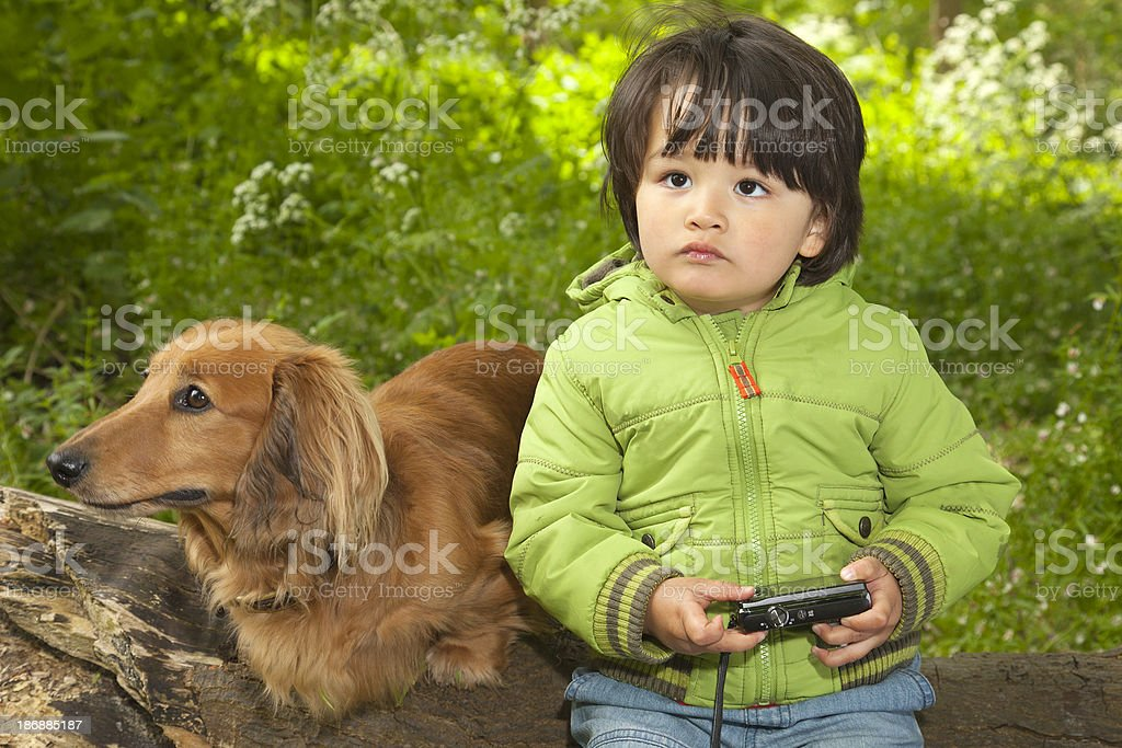 Boy with Camera and Dog royalty-free stock photo
