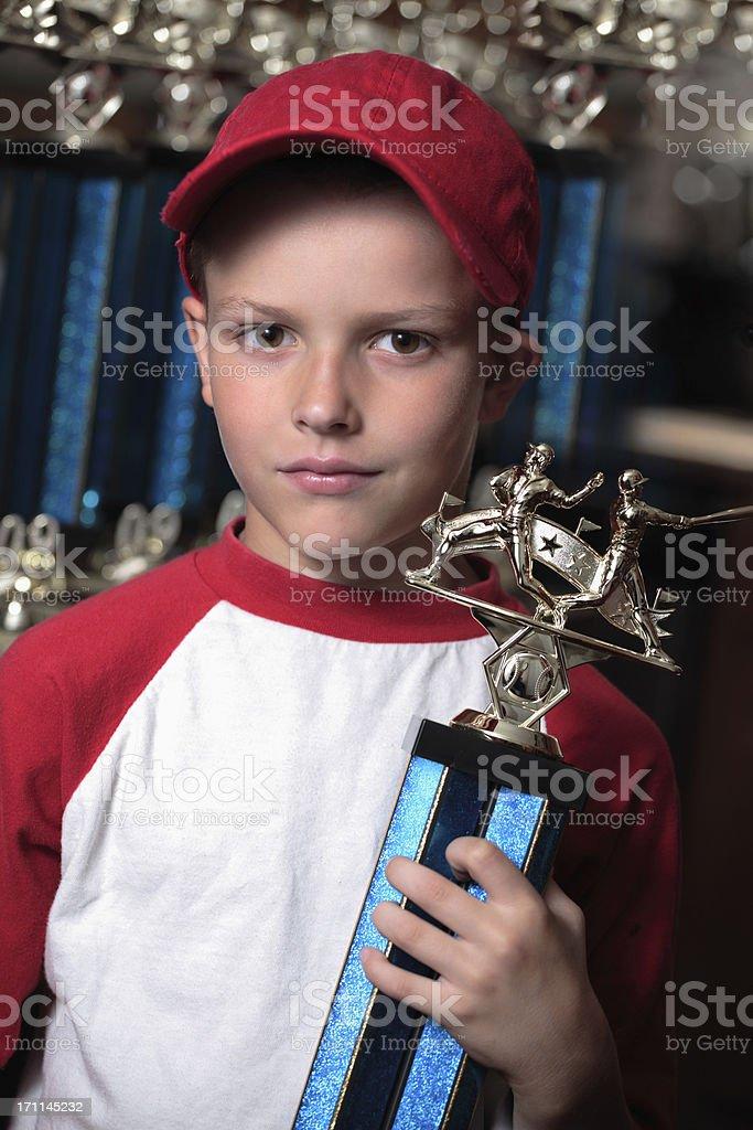 Boy with championship baseball trophy stock photo