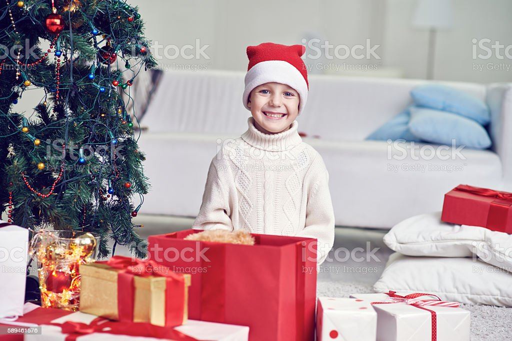 Boy with Christmas presents stock photo