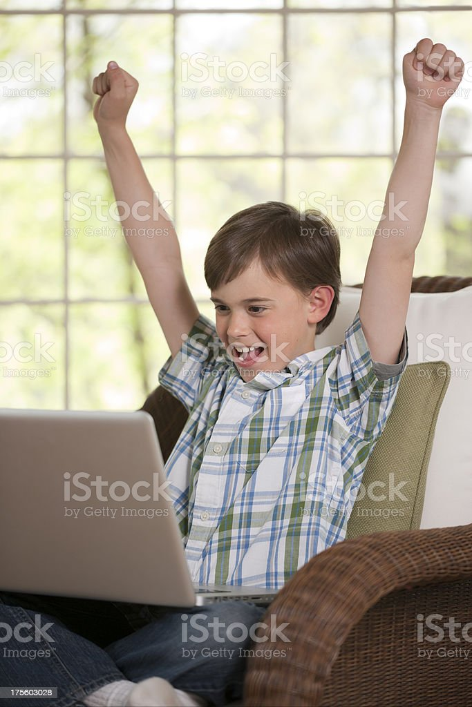 Boy with Computer Cheering stock photo