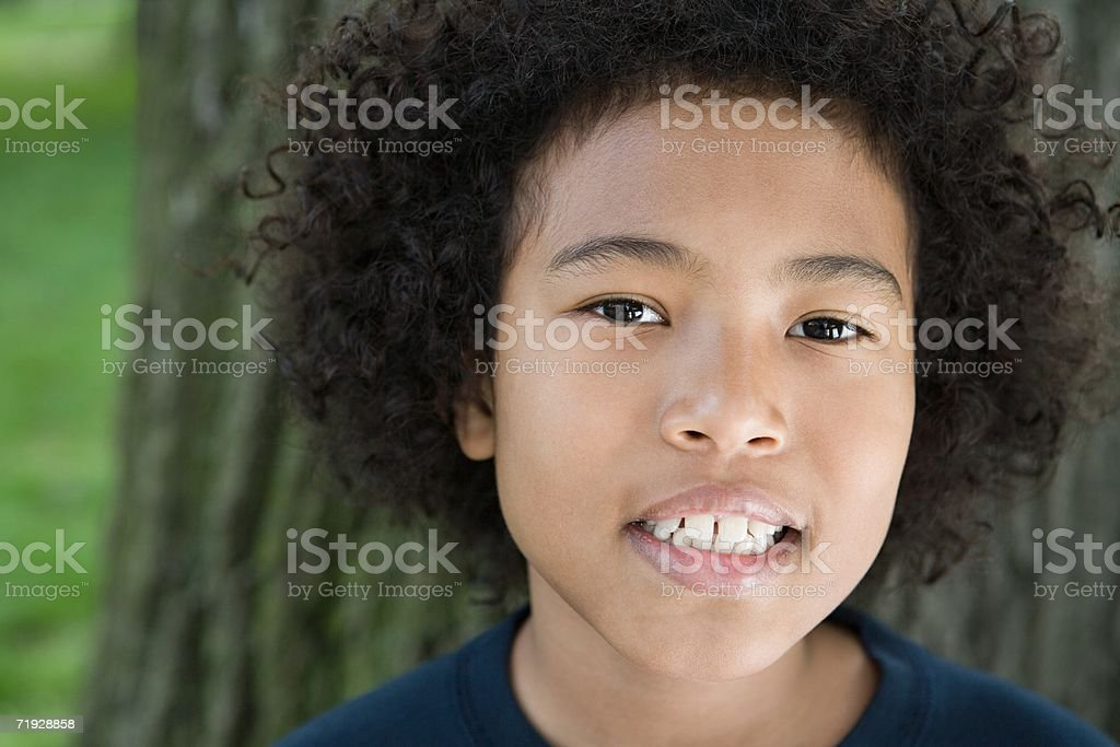 Boy with curly hair stock photo