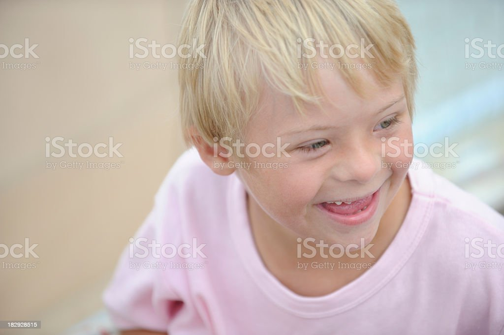 Boy with down syndrome is laughing royalty-free stock photo