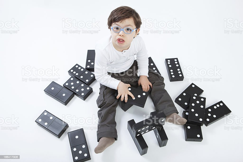 Boy with Down Syndrome playing royalty-free stock photo