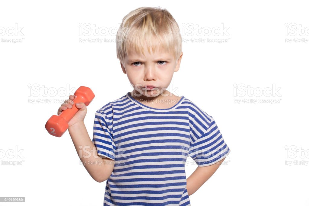 boy with dumbbell stock photo