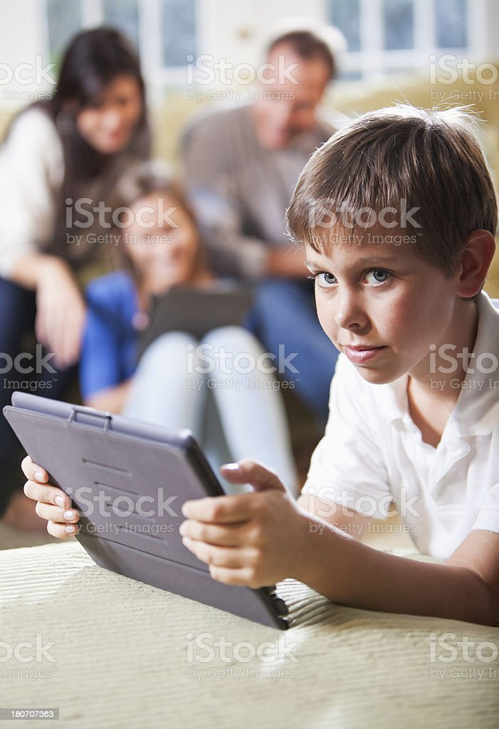 Boy with family using digital tablets royalty-free stock photo